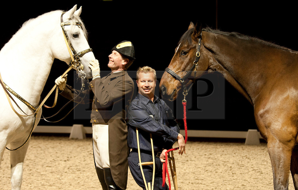 © Licensed to London News Pictures. 14/11/2012. Birmingham,UK. The world's most successful paralympic dressage rider Lee Pearson CBE, paid a visit to the NIA in Birmingham to perform alongside the Spanish Riding School of Vienna and their famous white Lipizzaner Stallions. They perform together on the 16th,17th and 18th of this month. Pictured, Lee Pearson and his horse Zion, meet Pluto, ridden by Herwig Radnetter.  Photo credit : Dave Warren/LNP