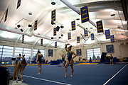 Emma McLean of the Michigan Wolverines and teammates warm up during an intrasquad meet at the Donald R. Shepherd Women's Gymnastic Center on November 16, 2018 in Ann Arbor, Michigan.