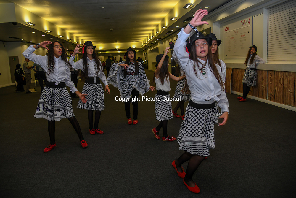 Fatafeat of Dabke Group performs at Palestine Expo 2019 on 7 July 2019, at London Olympia, UK.