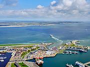 Nederland, Noord-Holland, gemeente Den Helder, 07-05-2021; zicht op de TESO veerhaven, de veerpont naar Texel is zojuist vertrokken. Texel aan de horizon. <br /> View of the TESO ferry port, the ferry to Texel has just left. Texel on the horizon.<br /> <br /> luchtfoto (toeslag op standard tarieven);<br /> aerial photo (additional fee required)<br /> copyright © 2021 foto/photo Siebe Swart