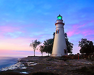 The Marblehead Lighthouse Radiates It's Green Light As The Sun Warms The Eastern Sky Initiating A Brand New Day At Marblehead Ohio On Lake Erie, USA