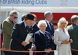 © Licensed to London News Pictures. 13/05/2015. Windsor, UK. HRH Queen Elizabeth II and Camilla, Duchess of Cornwall watch over the Cuddy Heavyweight Hunter class during day one of the 2015 Royal Windsor Horse Show, set in the grounds of Windsor castle in Berkshire, UK. Photo credit : Ben Cawthra/LNP