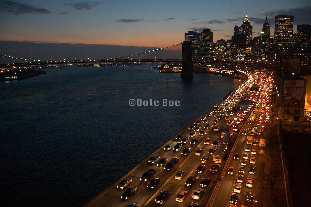 evening rush hour East River Highway New York City with Brooklyn Bridge