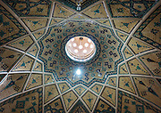 Stunning photographs reveal the beautiful ceilings in Iran's mosques, bazaars and public baths<br /> <br /> For the past few decades, restrictions on travel to Iran has meant the country has been largely shut off from the Western world, butas visa sanctions are lifted in the light of a landmark nuclear deal, the local tourism industry is hoping for a flurry of visitors.<br /> It's not hard to see why Iran is listed as one of the top travel destinations of 2016, with its rich culture and history.<br /> Among the standout aspects of the nation is its beautiful ancient architecture, with the cities and towns littered withornate and eye-catching mosques, public baths and markets.<br /> And unlike many other countries - the roof is not an afterthought, with many ceilings built as the centrepiece to the building, with many of the tile designs showcasing a display of intricate geometric patternsthatdate back several centuries.<br /> French photographerEric Lafforgue has travelled the country photographing the ceilings of indoor markets, mosques and bath houses.<br /> <br /> Photo shows: Ceiling With Its Intricate And Elaborate Patterns And Internal Stainless Glass Dome In Sultan Amir Ahmad Bathhouse Ceiling