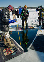 Ice dive training and demo on Meredith Bay with East Coast and NH Central Divers.  Karen Bobotas for the Laconia Daily Sun