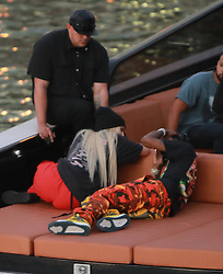 "EXCLUSIVE: Kylie Jenner goes back to being a blonde (like she was with X-Boyfriend Tyga) seen here are the first pictures of a very ""BLONDE"" Kylie Jenner and her new boyfriend Jacques Webster, Jr. better know as hip-hop singer Travis Scott. The lovebirds arrived by yacht and dined in a private back room of the exclusive restaurant the River Yacht Club where Kylie and Travis looked very happy and were spotted kissing and being very romantic while bodyguards kept out unwanted people. The new couple had a blast at the exclusive waterside restaurant where they were joined by Miami-based restaurant, nightlife and hospitality entrepreneur David Grutman and his wife Isabela Rangel. While Kylie drank Evian water all night her new man Rapper Travis Scott was in full party mode and did a total of 17 shots of Don Julio 1942™- World's First Luxury Tequila‎ with their friends. Perhaps the Tequila took its toll, as Travis looked a little under the weather on the boat ride home. The couple spent a total of $2000.00 with their friends and left a very generous additional $100.00 in addition to the 20% tip at The River Yacht Club Restaurant in Miami on May 7, 2017 in Miami, Florida. 07 May 2017 Pictured: Kylie Jenner, Travis-Scott. Photo credit: TBA / MEGA TheMegaAgency.com +1 888 505 6342"