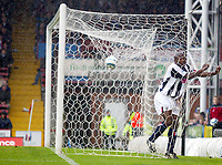 23/10/2004<br />FA Barclays Premiership - Crystal Palace v West Bromich Albion - Selhurst Park<br />West Bromich Albion defender Darren Moore lands in the back of the net as the ball lands on top of the net during his team's 3-0 loss.<br />Photo:Jed Leicester/Back Page Images