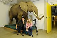 Photographers Heidi and Hans-Juergen Koch with prepared African elephant,.Senckenberg Natural History Collection Dresden..Fotografen Heidi und Hans-Juergen Koch mit praepariertem Afrikanischen Elefant, .Senckenberg Naturhistorische Sammlungen Dresden.