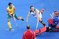 Erasmus Pieterse of South Africa saves from Jamie Dwyer of Australia during the men's Hockey match between Australia and South Africa held at the Riverbank Stadium in the Olympic Park in London as part of the London 2012 Olympics on the 30th July 2012.Photo by Ron Gaunt/SPORTZPICS