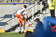 Blackpool Midfielder, Viv Solomom-Otabor (17) and Blackpool Forward, Kyle Vassell (7) celebrate after he scores the opening goal to a mark it 0-1 during the EFL Sky Bet League 1 match between Portsmouth and Blackpool at Fratton Park, Portsmouth, England on 24 February 2018. Picture by Adam Rivers.