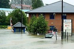 An almost totaly submerged car after torrential rain causes flooding and traffic chaos and damage Newton Chambers Industrial estate Chapeltown Sheffield South Yorkshire.25 June 2007.Image COPYRIGHT Paul David Drabble.