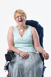 Portrait of a female wheelchair user laughing,