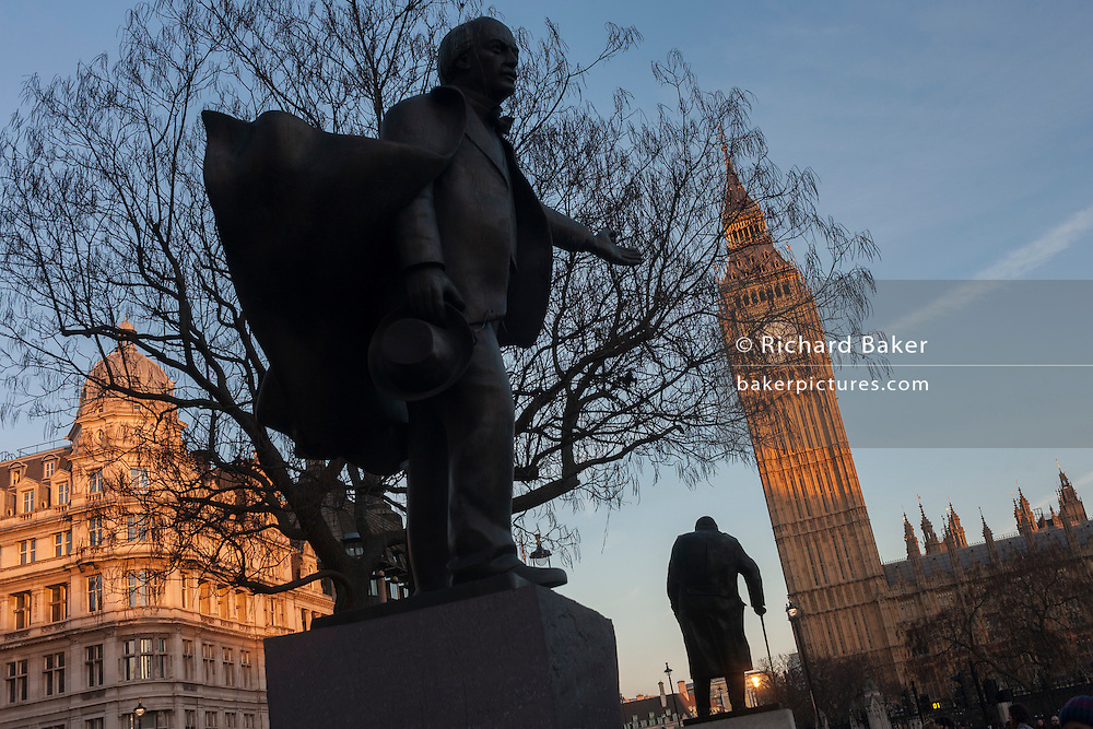 The silhouetted statues of David Lloyd-George and Winston Churchill, on 17th January 2017, in Parliament Square, Westminster, London England.