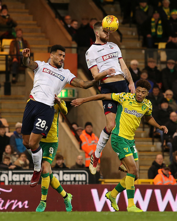 Bolton Wanderers' Mark Beevers wins the aerial battle with Norwich City's Jamal Lewis<br /> <br /> Photographer David Shipman/CameraSport<br /> <br /> The EFL Sky Bet Championship - Norwich City v Bolton Wanderers - Saturday 8th December 2018 - Carrow Road - Norwich<br /> <br /> World Copyright © 2018 CameraSport. All rights reserved. 43 Linden Ave. Countesthorpe. Leicester. England. LE8 5PG - Tel: +44 (0) 116 277 4147 - admin@camerasport.com - www.camerasport.com