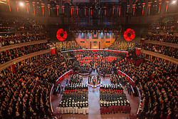 © Licensed to London News Pictures. 08/11/2014.  London. Poppies fall from the roof of the Royal Albert Hall during a one minute silence during the Royal British Legions festival of remembrance.  Photo credit : Alison Baskerville/LNP