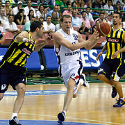 Efes Pilsen's Sinan GULER (C) and Fenerbahce Ulker's Roko Leni UKIC (R), Omer ONAN (L) during their Turkish Basketball league Play Off Final fifth leg match Efes Pilsen between Fenerbahce Ulker at the Ayhan Sahenk Arena in Istanbul Turkey on Sunday 30 May 2010. Photo by Aykut AKICI/TURKPIX