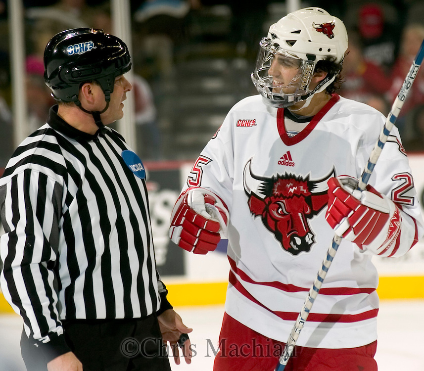 12/31/05  Omaha, NE University of Nebraska at Omaha's Bryan Marshall talks with Linesman Mark Baratta at the end of the first period in a game against Yale University  Saturday  night...(photo by Chris Machian/Prarie Pixel Group)