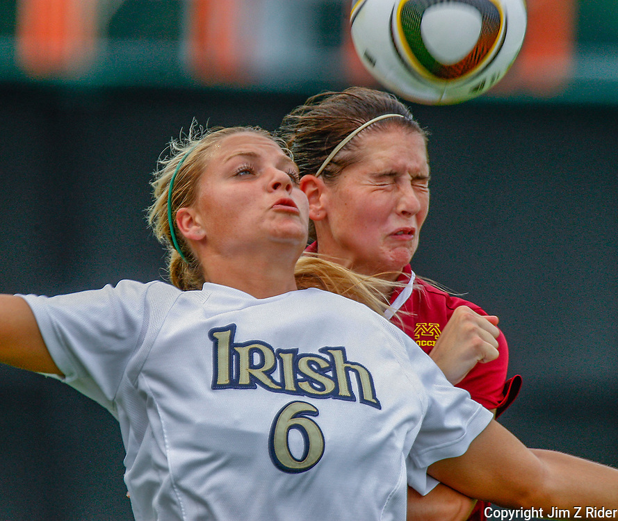 A Notre Dame women's soccer player fights for control of the ball.