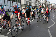Cycling enthusiasts in lycra on The Strand, London, UK.