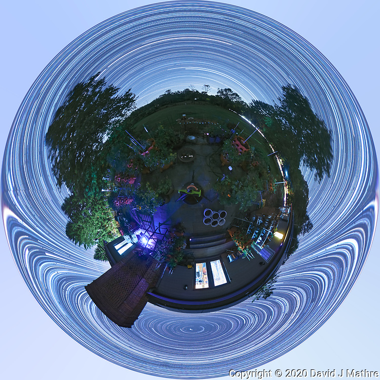 Backyard Late Summer Nighttime Sky Over New Jersey. Little Planet 360 degree Panorama. Composite of 360 (DNG) images taken with a Ricoh Theta Z1 360 camera (ISO 400, 2.6 mm, f/2.1, 60 sec). DNG images processed with Capture One Pro, converted to 360 Equirectangular with PTGUI, Star Trail composite generated with PhotoShop CC (scripts, statistics, maximum). Little Planet view created with PhotoShop CC  (image size 1:1, image rotated 180 degrees, filter, distort, polar coordinates).