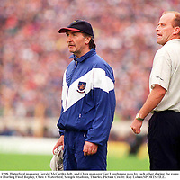 19 July 1998. Waterford manager Gerald McCarthy, left, and Clare manager Ger Loughnane pass by each other during the game. Munster Hurling Final Replay, Clare v Waterford, Semple Stadium, Thurles. Picture Credit: Ray Lohan/SPORTSFILE.