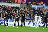 Man city's Fernandinho © celebrates after he scores his sides 1st goal. Barclays Premier league, Swansea city v Manchester City at the Liberty Stadium in Swansea,  South Wales on  New years day Wed 1st Jan 2014 <br /> pic by Andrew Orchard, Andrew Orchard sports photography.