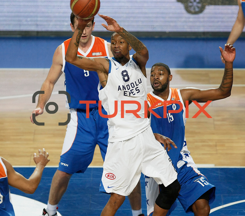 Anadolu Efes's Terence Kinsey (C) and Mersin BSB's Vincent Grier (R) during their Turkish Basketball League match Anadolu Efes between Mersin BSB at Sinan Erdem Arena in Istanbul, Turkey, Saturday, January 14, 2012. Photo by TURKPIX