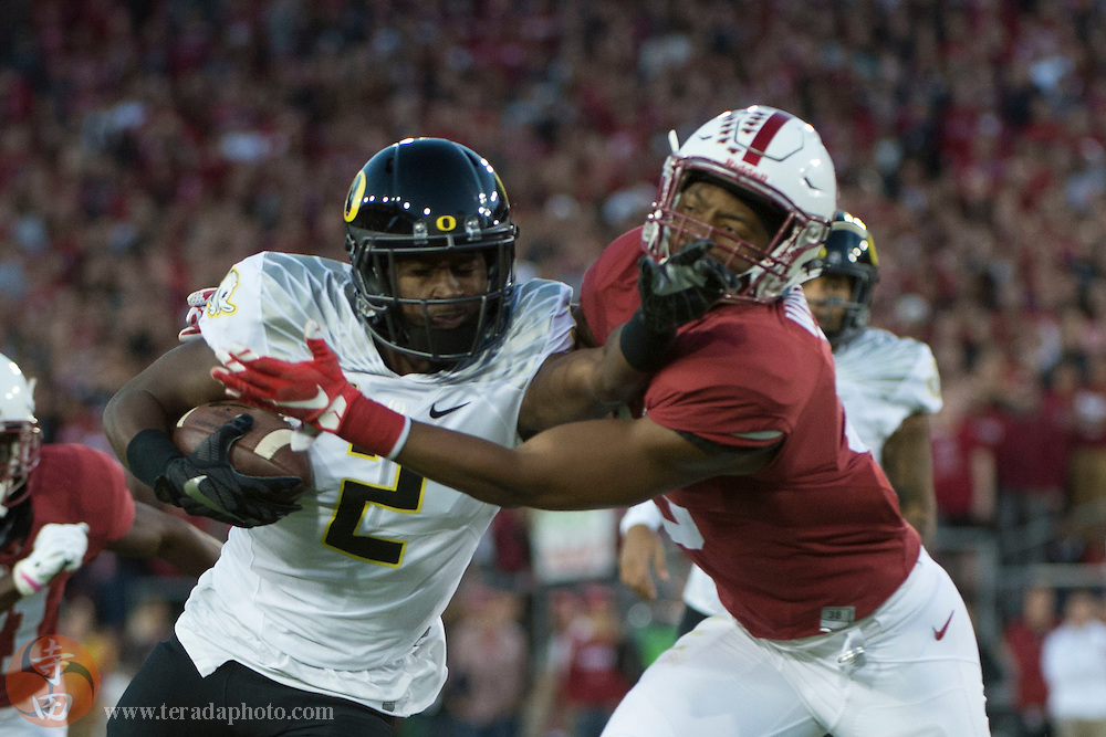 November 14, 2015; Stanford, CA, USA; Oregon Ducks wide receiver Bralon Addison (2) runs with the football against Stanford Cardinal safety Kodi Whitfield (5) during the first quarter at Stanford Stadium.