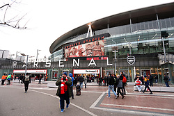 Fans outside the ground ahead of the Premier League match at the Emirates Stadium, London
