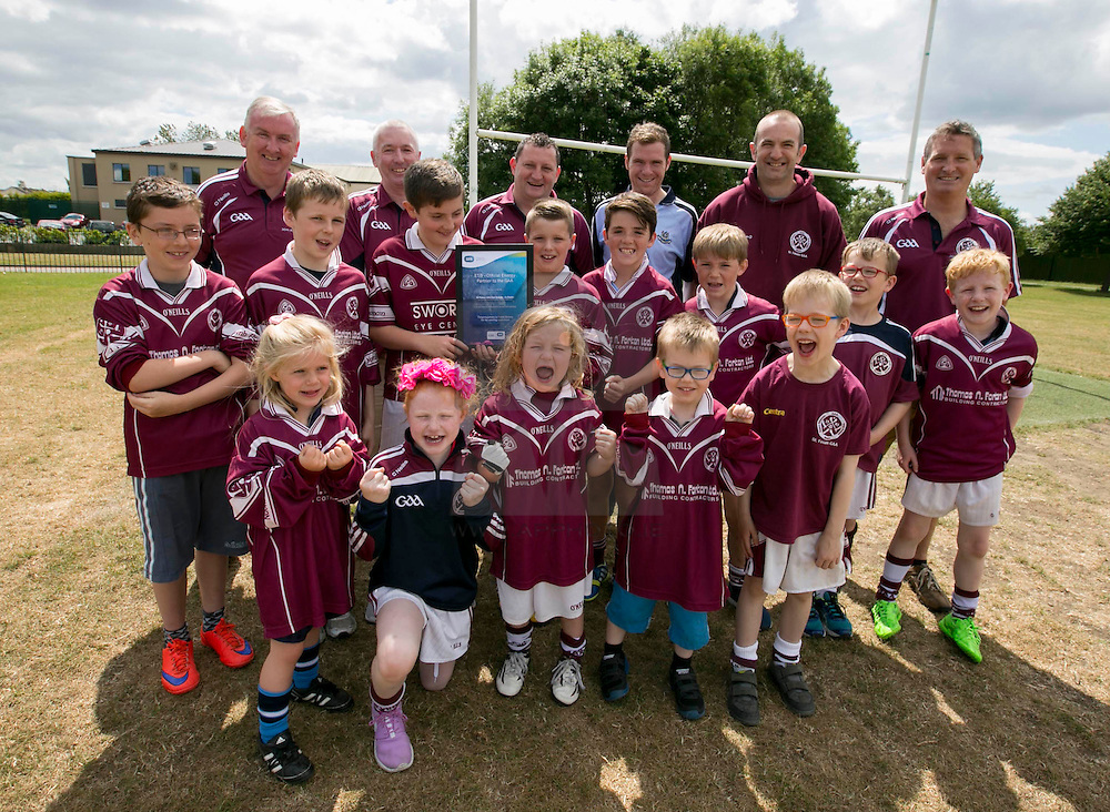 Repro Free: Dublin July 2015: ESB, Official Energy Partner to the GAA, presents St Finians GAA Club in Swords with a cheque for €1,500. The prize is part of ESB's GAA Fund whereby ESB staff members nominated a local GAA club that is making a difference in the community. Over the coming weeks, a grand total of €30,000 will be awarded to twenty GAA clubs across the country. <br /> <br /> St Finians GAA Club was nominated for the award by ESB staff member Paddy Mulvey.<br /> <br /> Pictured at the presentation in the club is (back) Denis O'Keeffe, sponsorship officer, Pat Farrell, Tresurer, Barry Shelly, Chairman, Paddy Mulvey from ESB, Ciaran Crosbie, Secretary and Paul Dever, juvenial chairman with some enthusiastic junior club members. Picture Andres Poveda<br /> <br /> <br /> <br /> ENDS<br /> <br /> For further information, please contact:<br /> Wilson Hartnell<br /> Rachel Solon / Sarah Gallagher<br /> rachel.solon@ogilvy.com / sarah.gallagher@ogilvy.com    <br /> 01 6690030 / 087 6245326 / 086 3517969