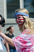 BAR HARBOR, MAINE, July 4, 2014. A rider on a float in the Independence Day Parade has painted her face with the US flag.