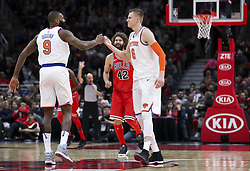 December 27, 2017 - Chicago, IL, USA - The New York Knicks' Kyle O'Quinn (9) fist bumps teammate Kristaps Porzingis (6) during the first half against the Chicago Bulls at the United Center in Chicago on Wednesday, Dec. 27, 2017. (Credit Image: © Armando L. Sanchez/TNS via ZUMA Wire)