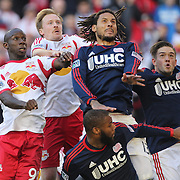 From left, Bradley Wright-Phillips, Dax McCarty, New York Red Bulls, Jermaine Jones and Kelyn Rowe, New England Revolution, challenge for the ball from corner kick during the New York Red Bulls Vs New England Revolution, MLS Eastern Conference Final, first leg at Red Bull Arena, Harrison, New Jersey. USA. 23rd November 2014. Photo Tim Clayton