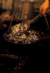 preparing a pot of food at a campsite