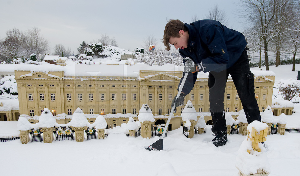 © under license to London News Pictures. 21/12/2010. A snow covered Lego London at Miniland, Legoland Windsor this morning (21/12/2010) following further snowfall last night. Pictured is model maker Joel brushing snow from the life Buckingham Palace. Photo credit should read: London News Pictures