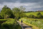 Women walks down a country lane, Oxfordshire, United Kingdom