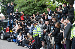 © licensed to London News Pictures.  26/07/2011. London, UK. Photographers watch guests arriving at the funeral service of singer Amy Winehouse at Gouldes green Crematorium in Goulders Green North London today (26/07/2011). In line with Jewish tradition, the private service took place as soon as possible after the singer's death. Photo credit Ben Cawthra/LNP
