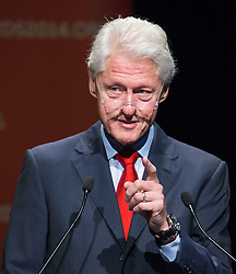 © Licensed to London News Pictures. 23/07/2014. Former US President Bill Clinton points while speaking during a session of the 20th International AIDS conference held in Melbourne Australia. Photo credit : Asanka Brendon Ratnayake/LNP
