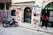 Graffiti on a wall in the area of Plaka. Plaka is the old historical neighborhood of Athens, clustered around the northern and eastern slopes of the Acropolis, and incorporating labyrinthine streets and neoclassical architecture. Plaka is built on top of the residential areas of the ancient town of Athens. It is known as the 'Neighbourhood of the Gods' due to its proximity to the Acropolis and its many archaeological sites. Visitors to Athens can't help but notice the amount of graffiti in the city. Any surface that can be sprayed upon is covered with a maddening number of signatures and designs. Beautifully restored neo-classic houses from the late 19th Century usually have a few days or weeks before they are covered in graffiti and owners find themselves in a war that they eventually lose and surrender to the kids. Graffiti in Athens is as old as the city itself. In ancient times graffiti was carved into buildings, in fact the word comes from the Greek graphi which means to write. The most disturbing aspect of the graffiti besides the volume of it, is the way some of the kids whose artistic ability begins and ends with their names (tags), have defaced some of the real works of art. Athens is the capital and largest city of Greece. It dominates the Attica periphery and is one of the world's oldest cities, as its recorded history spans around 3,400 years. Classical Athens was a powerful city-state. A centre for the arts, learning and philosophy.