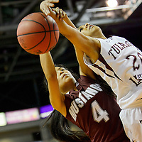 031114  Adron Gardner/Independent<br /> <br /> Ramah Mustang Cauy Duboise (4) knocks away a shot by  Tularosa Wildcat Aviana Garcia (20) during the state high school basketball tournament at the Santa Ana Star Center in Rio Rancho Tuesday.
