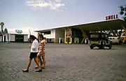 Shell petrol station near Sao Paulo, Brazil, 1962 Volkswagen car dealership in background