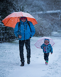 © Licensed to London News Pictures. 10/12/2017. Reading, UK. A man and his daughter walk in fresh snow near Reading, Berkshire, as parts of the south east of England are blanketed with snow for the first time this winter. Photo credit: Peter Macdiarmid/LNP