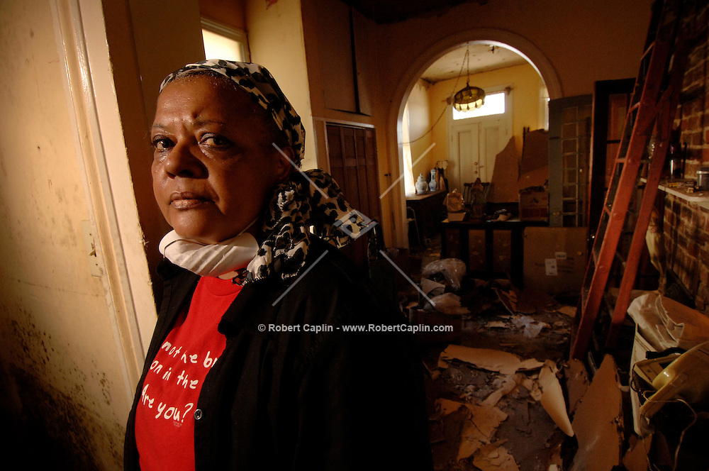 """""""I could just cry."""" ..New Orleans resident Earline Melton's home was destryoed not by high floodwaters, but damage and leaks from her roof.  (Robert Caplin/New York Times)"""