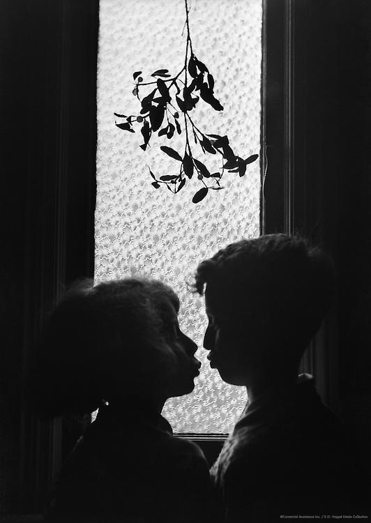 Kissing under the mistletoe, England, 1932
