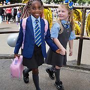 St Catherine's School, Barmulloch, Glasgow. Primary 1 pupils Zoey Adewnigi (left) and Kendall Wright (right) arrive for their first day. <br /> <br /> The school has 58 children in the 3 P1 classes.<br /> The school is in North East Glasgow with a roll of 486 and has 85% of children living in SIMD 1 & 2. (Scottish Index of Multiple Deprivation).<br />  <br /> Picture Robert Perry 12th August 2020<br /> <br /> Must credit photo to Robert Perry<br /> FEE PAYABLE FOR REPRO USE<br /> FEE PAYABLE FOR ALL INTERNET USE<br /> www.robertperry.co.uk<br /> NB -This image is not to be distributed without the prior consent of the copyright holder.<br /> in using this image you agree to abide by terms and conditions as stated in this caption.<br /> All monies payable to Robert Perry<br /> <br /> (PLEASE DO NOT REMOVE THIS CAPTION)<br /> This image is intended for Editorial use (e.g. news). Any commercial or promotional use requires additional clearance. <br /> Copyright 2018 All rights protected.<br /> first use only<br /> contact details<br /> Robert Perry     <br /> <br /> no internet usage without prior consent.         <br /> Robert Perry reserves the right to pursue unauthorised use of this image . If you violate my intellectual property you may be liable for  damages, loss of income, and profits you derive from the use of this image.