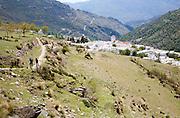Walkers near the village of Capileira, High Alpujarras, Sierra Nevada, Granada province, Spain
