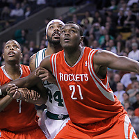06 March 2012: Boston Celtics power forward Chris Wilcox (44) vies for the rebound with Houston Rockets center Samuel Dalembert (21) and Houston Rockets point guard Kyle Lowry (7) during the Boston Celtics 97-92 (OT) victory over the Houston Rockets at the TD Garden, Boston, Massachusetts, USA.