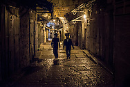 Two Haredim walk back from the Western Wall through the Christian quarter towards Jaffa gate, one of the main gates to enter Jerusalem Old City
