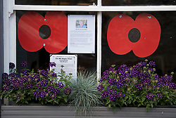 © Licensed to London News Pictures. 10/07/2020. London, UK. A picture of Dame Vera Lynn and poppies in a window display of a pub in the town of Ditchling, East Sussex, ahead of the funeral of Dame Vera Lynn. The 'Forces' Sweetheart', who died last month aged 103, was famous for singing performances during WW2, which helped raise morale amongst troops abroad. Photo credit: Ben Cawthra/LNP