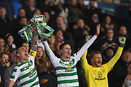 Scott Brown, Mikael Lustig and Scott Bain after winning the Betfred Cup Final between Celtic and Aberdeen at Hampden Park, Glasgow, United Kingdom on 2 December 2018.